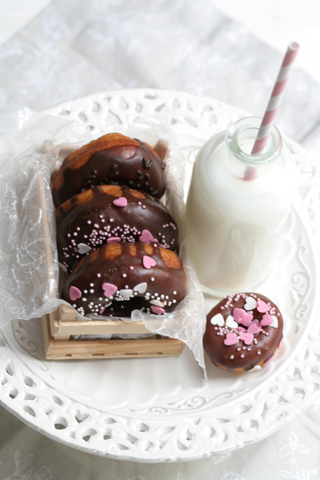 Choco Glazed Donuts on Tray with Milk and Sprinkles
